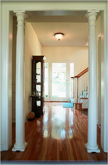 The stairway space to the second floor was taken from an existing bedroom. We matched the hardwood flooring that was typical throughout the home.