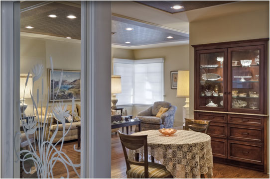 Here is a view from the family room, showing the dining room and living room.